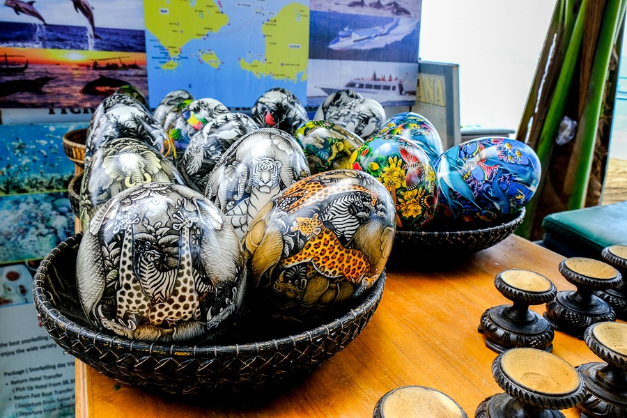 Basket of painted eggs for sale at Sanur Beach in Bali