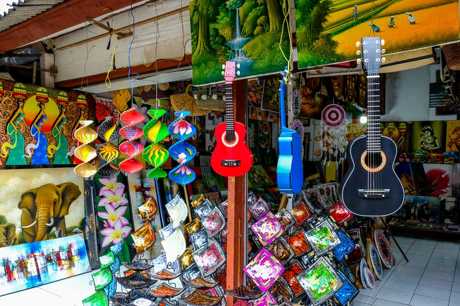 Paintings, guitars, and handmade souvenirs at the Ubud Market in Bali