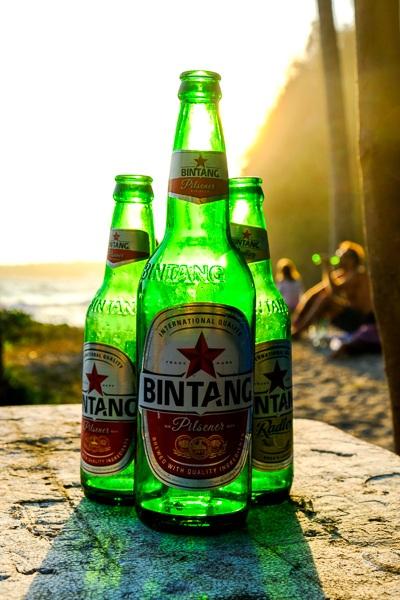 Bintang beer bottles in the sunset at Crystal Bay in Nusa Penida, Bali