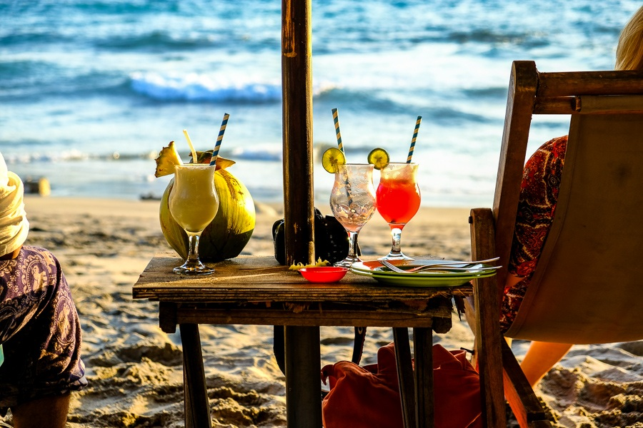Fresh fruit drinks on a beach table at Crystal Bay in Nusa Penida, Bali