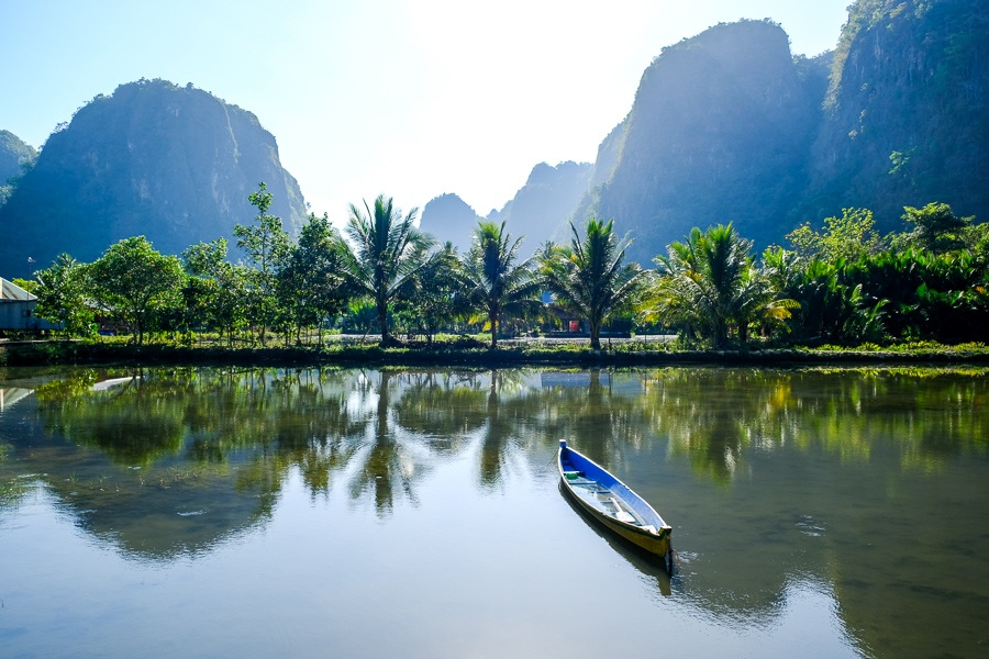 Canoe and reflection in the pond at Rammang Rammang Maros in Sulawesi