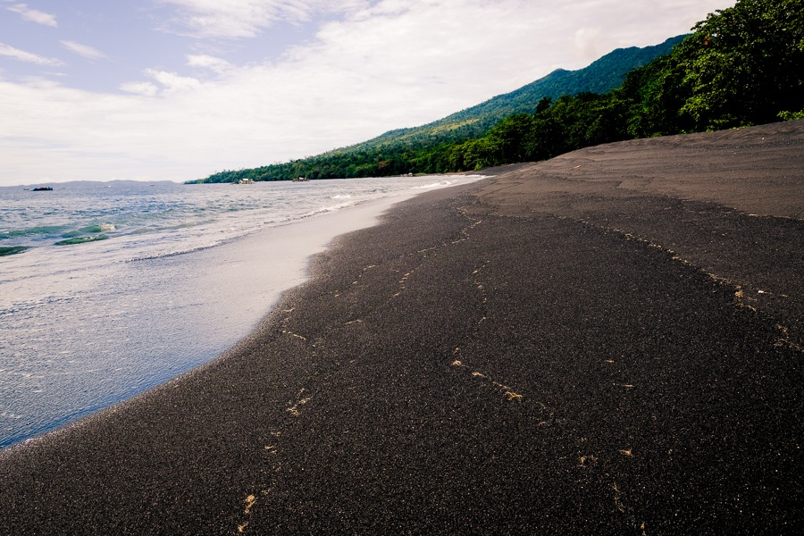 Black sand beach at the Tangkoko Nature Reserve in Sulawesi, Indonesia