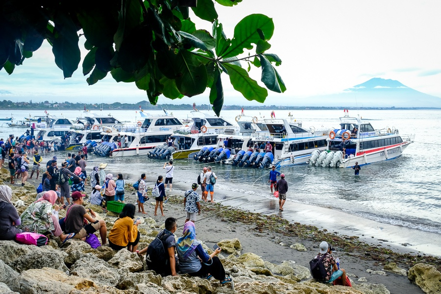 Boats and tourists lined up on Sanur Beach to go to Nusa Penida in Bali