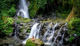 My woman sitting at Pengibul Waterfall in Bali