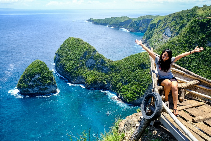 My woman happy and posing at Paluang Cliff in Nusa Penida, Bali