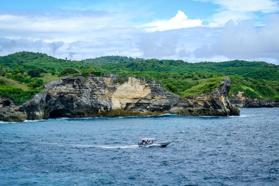 Speedboat near the coast at Broken Beach in Nusa Penida, Bali