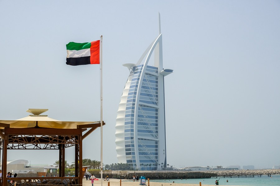 Oasis Beach Tower and UAE flag in Dubai