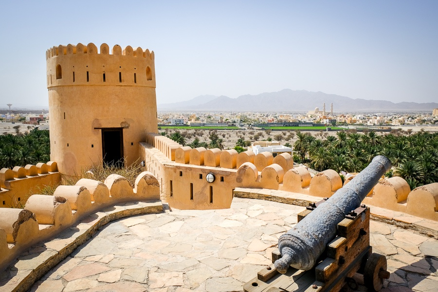 Cannon and tower on the rooftop at Nakhal Fort in Oman
