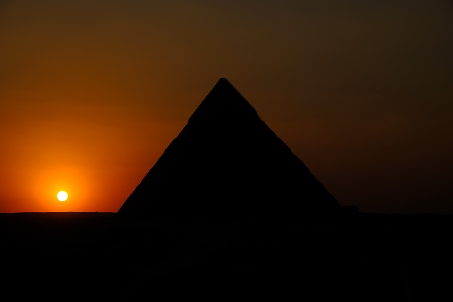 Sunset at night by the Great Pyramids of Giza in Egypt
