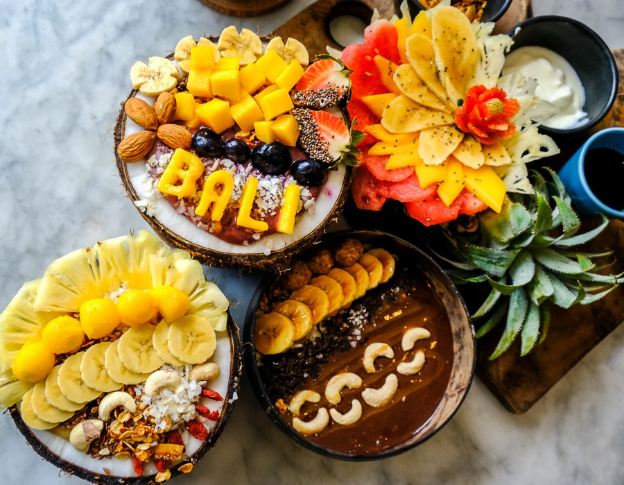 Artistic fruit smoothie bowls on a table at Cafe Organic in Canggu