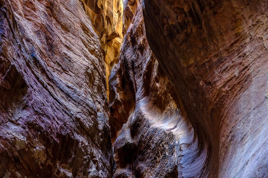 Narrow twisting rock ceilings of the Siq pathway in Petra, Jordan