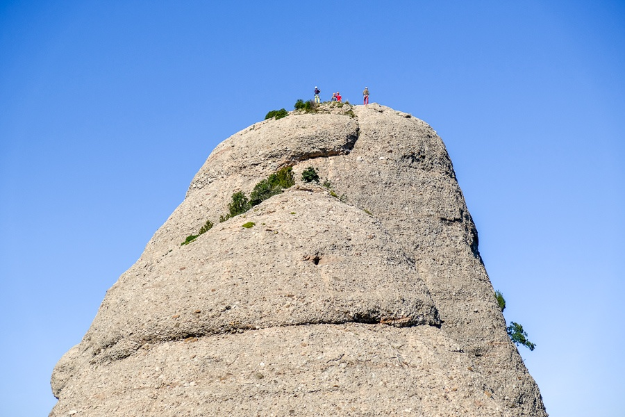 Group of rock climbers on a peak at Montserrat National Park in Spain