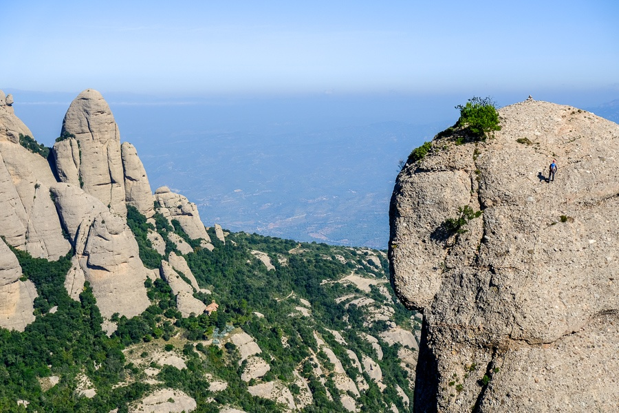 A rock climber high above the mountains at Montserrat National Park in Spain