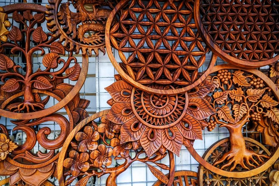 Circular Balinese wood carvings for sale in Ubud, Bali