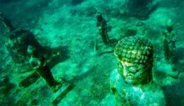 Underwater Buddha statue and temple ruins near Nusa Penida and Nusa Lembongan in Bali