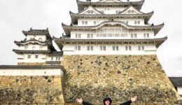 Travel guy posing in front of Himeji Castle in Japan