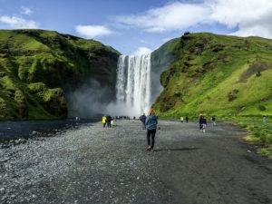 Tourists walking to Skogafoss Waterfall in Iceland