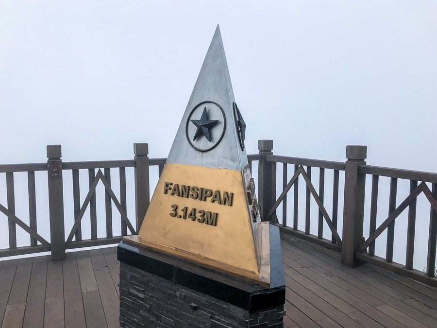 Top summit marker for 3,143 meters altitude at Fansipan mountain in Sapa, Vietnam
