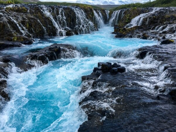 Blue water at Bruarfoss Waterfall hike in west Iceland