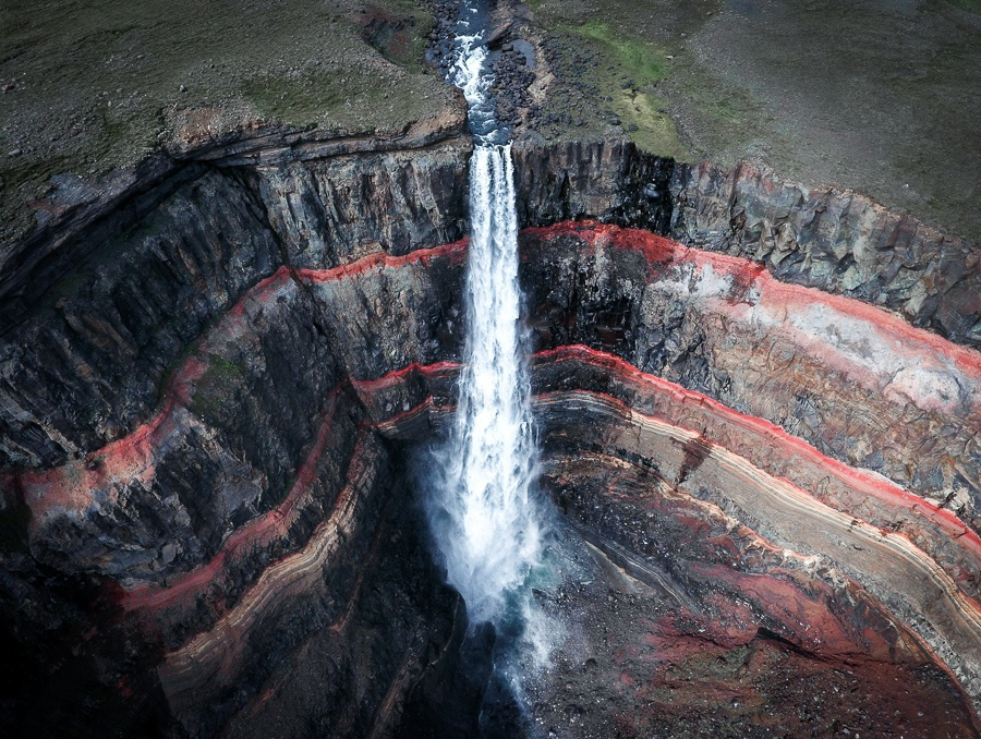 Drone view of the red rock formations at Hengifoss Waterfall in Iceland