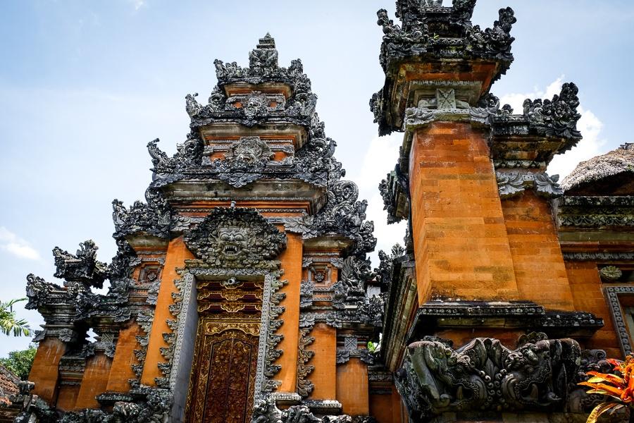 Carved walls at Pura Saraswati Temple in Ubud Bali