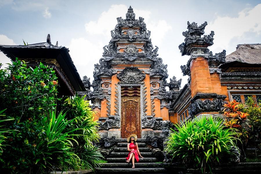 My woman at the doorway of Pura Saraswati Temple in Ubud Bali