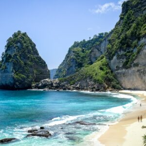 Tourists walking by the cliffs at Diamond Beach in Nusa Penida Bali