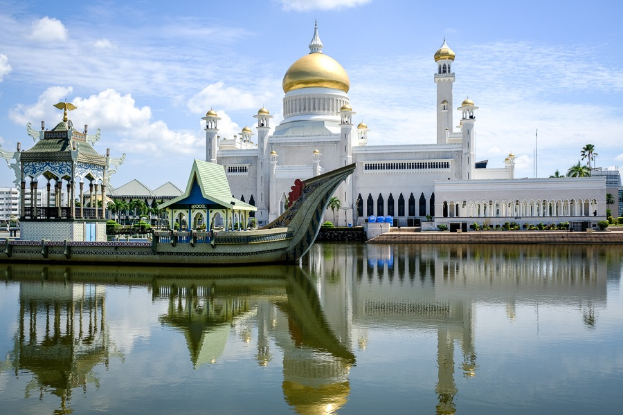 Water and boat reflection at the Sultan Omar Ali Saifuddien Mosque in Brunei