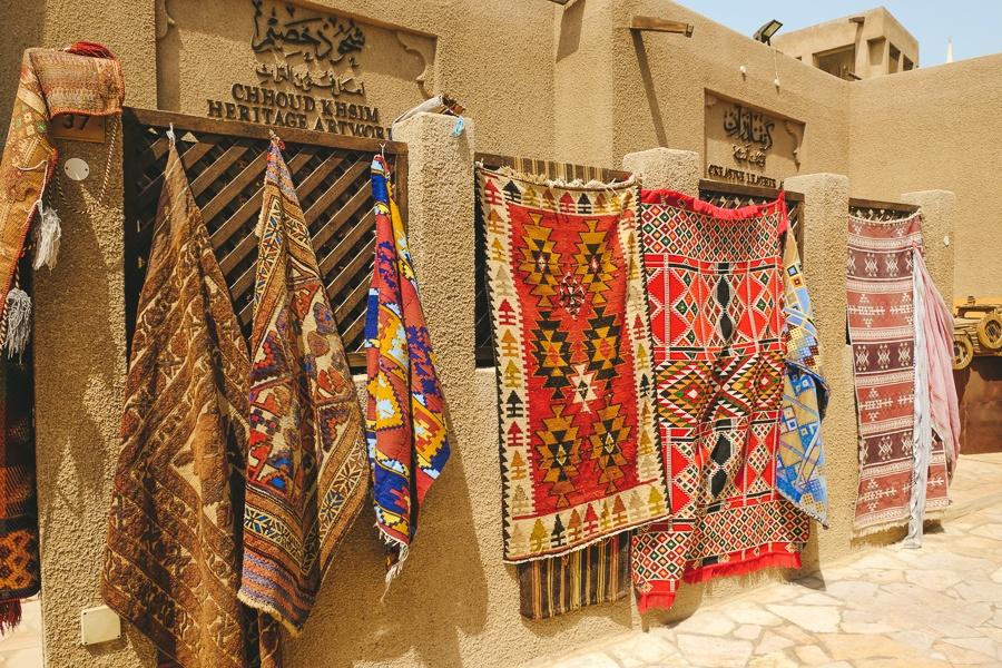 Rugs hanging at a market in the Al Fahidi Historical Neighborhood of Dubai, UAE