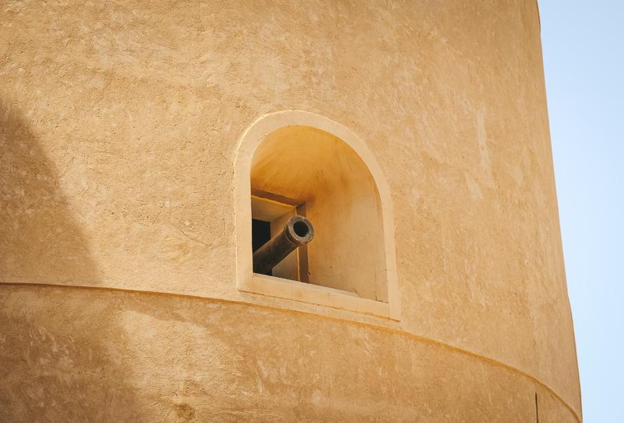 Cannon in a window at Al Hazm Castle in Oman
