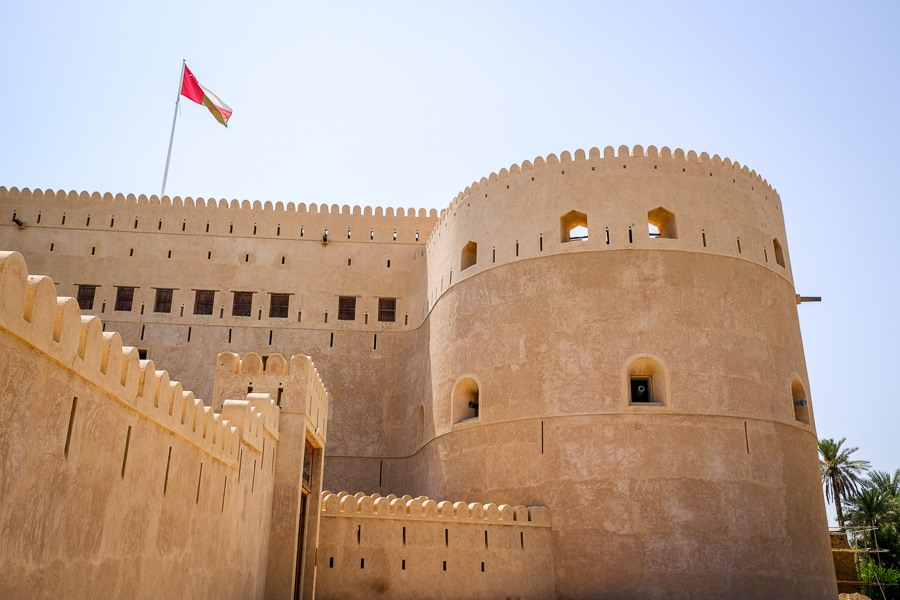 Side wall and Omani flag at Al Hazm Castle in Oman