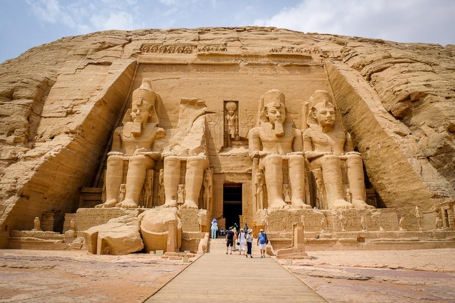 Tourists walking outside Abu Simbel Temple in Egypt