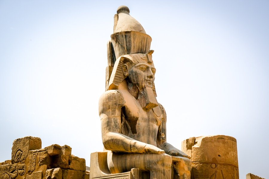 Statue of Rameses II sitting on a throne at Luxor Temple in Egypt