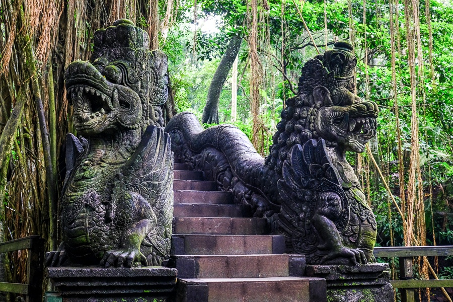 Dragon bridge and statues at the Ubud Monkey Forest in Bali