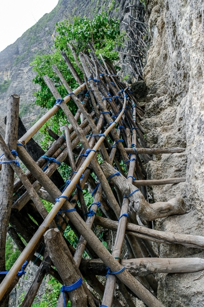 Steep trail and wooden railings at Pererenan Cliff in Nusa Penida, Bali