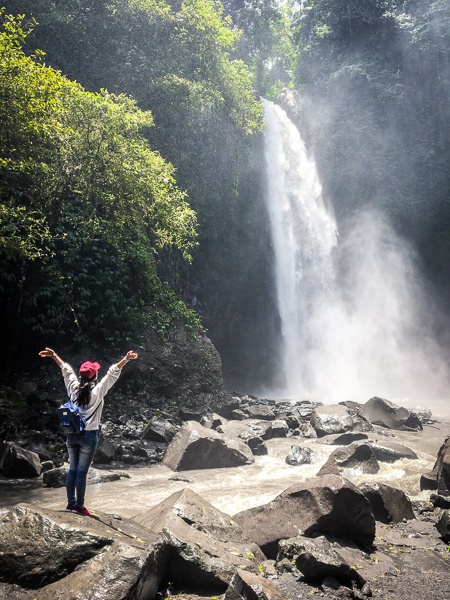 Hiker at Nungnung Waterfall in Bali
