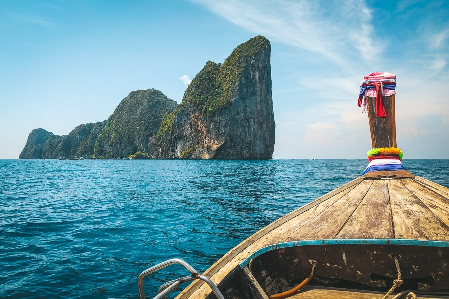 Boat approaching steep Phi Phi islands in Krabi, Thailand