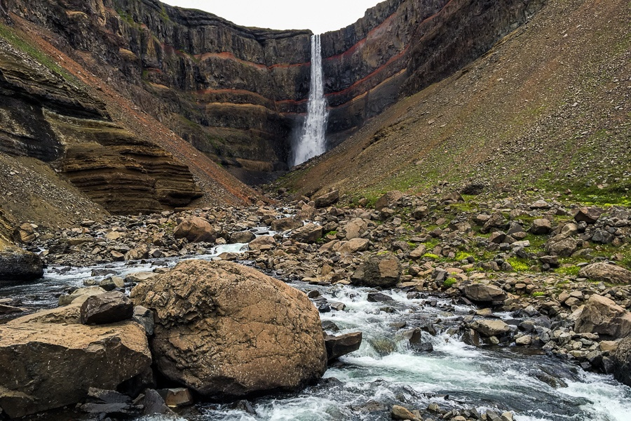 Boulders and stream at the Hengifoss Waterfall in Iceland