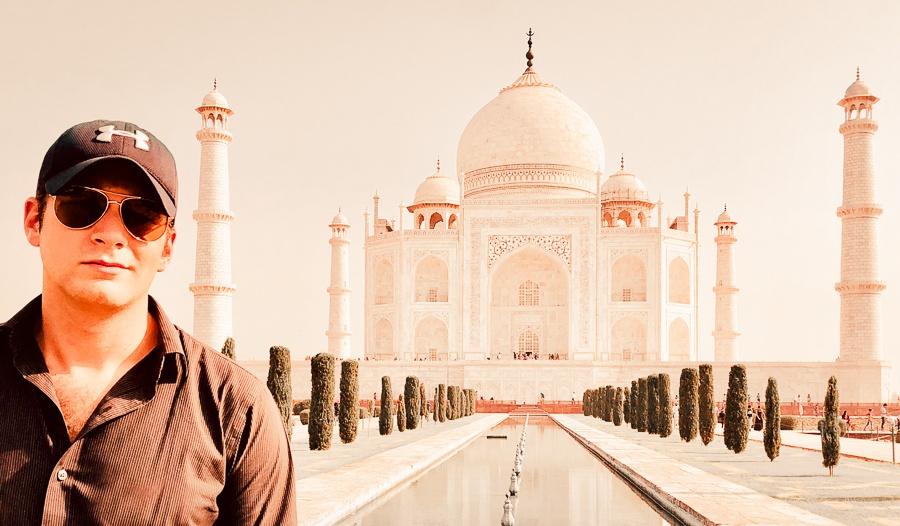 Travel guy in front of the Taj Mahal in Agra, India