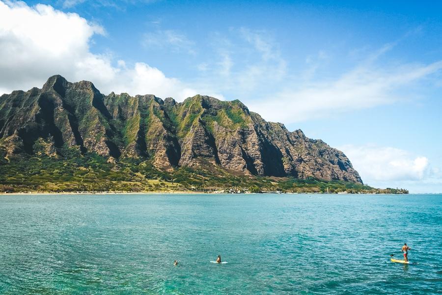 SUP paddlers near Kualoa beach in Oahu, Hawaii