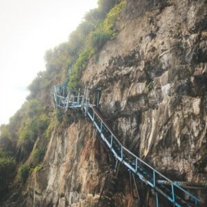 Old stairway on the cliff at Peguyangan Waterfall in Nusa Penida, Bali