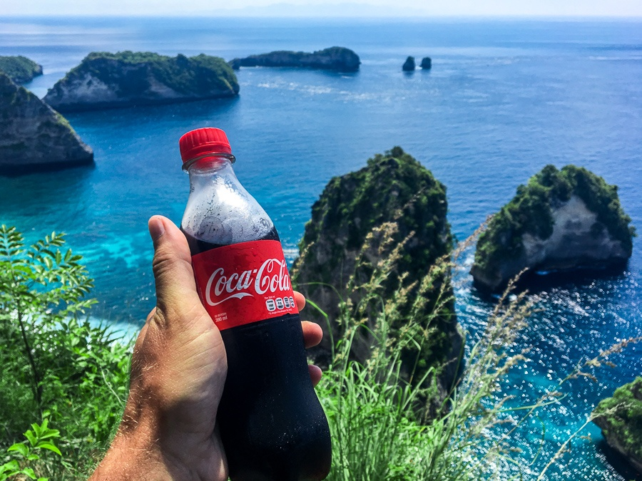 Holding Coca Cola at the Raja Lima viewpoint