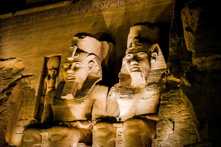 Abu Simbel Temple pharaoh statues lit up at night in Egypt