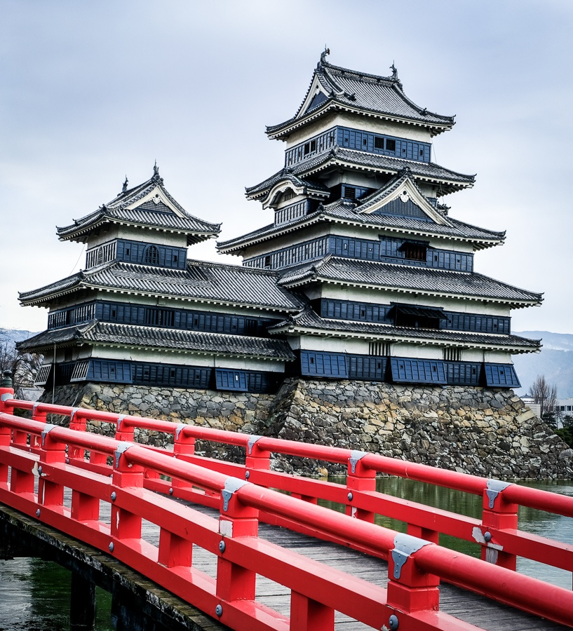 Red bridge at Matsumoto Castle in Japan