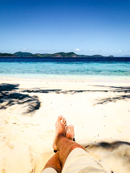 Travel guy relaxing on a beach in Coron, Palawan, Philippines