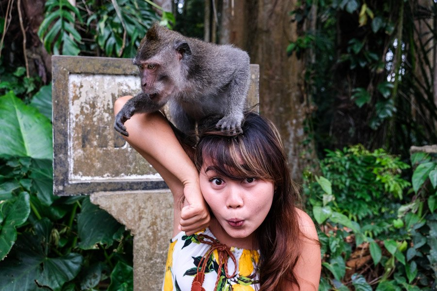 Girl holding a Bali monkey
