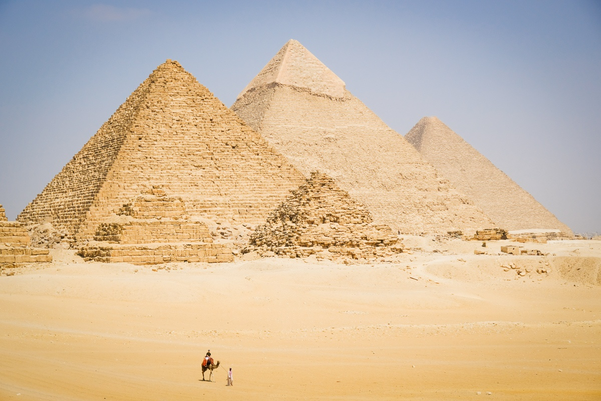 Camel walking in the distance at the Great Pyramids of Giza in Egypt