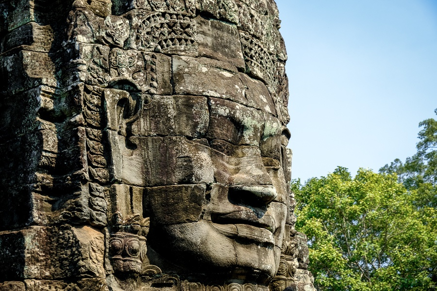 Carved stone face at the Angkor Wat temple in Cambodia