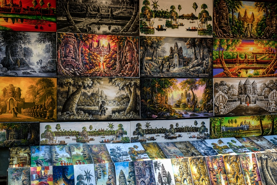 Paintings for sale at the river market in Siem Reap Cambodia