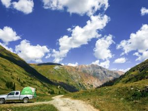 Truck parked on a dirt road in the mountains of Colorado